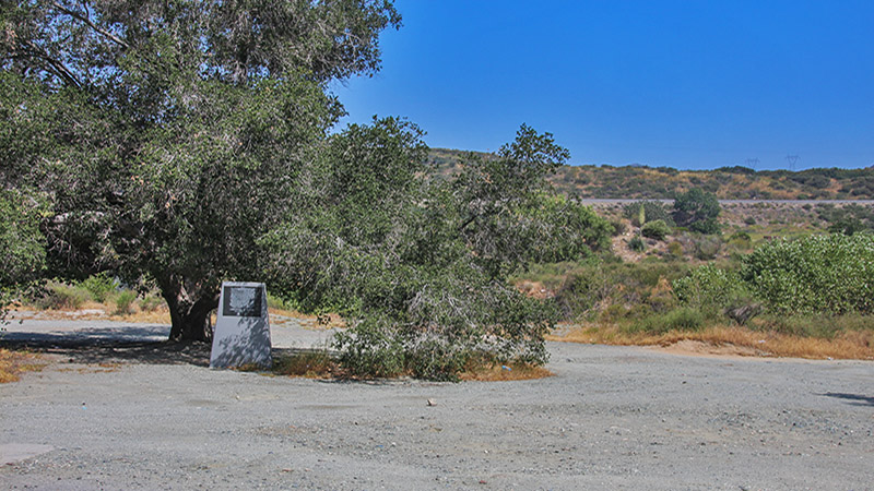 The monument is located about 20 feet from the old truck scales, which are still visible