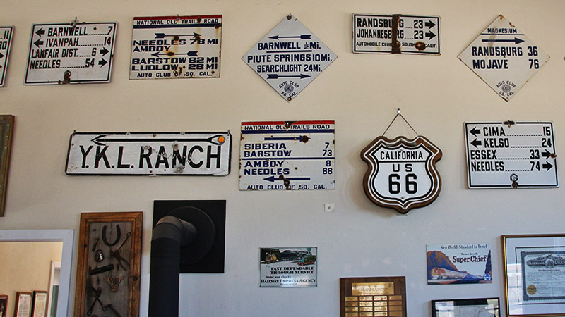 Preserved signs inside the museum which were originally placed by the AAA when Route 66 was built